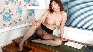 German mature Kristine dildos her hairy cunt