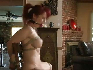 Gagged tied and fucked - Tied and gagged redhead toyed on a chair