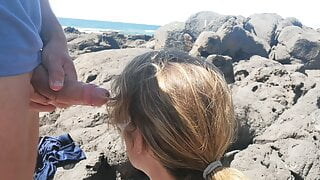 Exciting blowjob in public with people on the beach