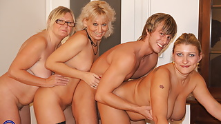 Home party with three mature mothers and step son