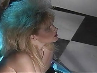 Wild tranny - Wild haired blonde bitch sucks off a mature trannys cock