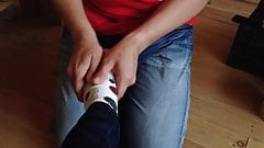 slave gives mistress a foot massage in socks and barefoot