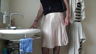 Demurely dressed crossdresser wanking and cumming