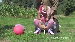 Horny babe fucks cock and toy in park and licks cum lollipop