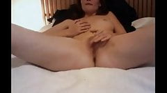 Webcam redhead plays on bed