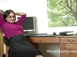 Upskirts celibrites - Sexy riani fingers her hairy pussy on the desk