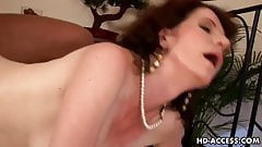 Wild cock gobbling brunette milf in action