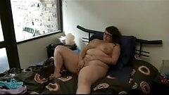 BBW masturbates herself to an orgasm on her bed