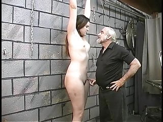 Shackled slave bdsm Blindfolded, gagged and shackled bdsm brunette gets vibrator held to her clit