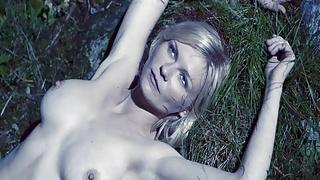 Kirsten Dunst topless in a movie