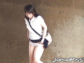 Japanese girls pissing Pretty japanese schoolgirl teasing clit and peeing