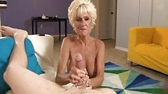 Slutty Mature Lady Jerks Off A Young Guy
