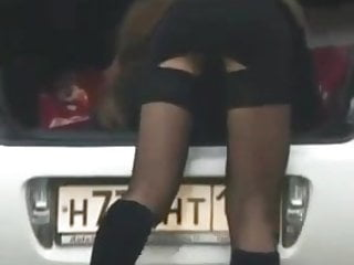 Upskirt miniskirts Girl changing shoes in miniskirt on street