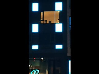 Night window voyeur My wife topless at hotel window at night