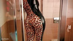 MILF in latex rubber catsuit in the bathroom fetish video