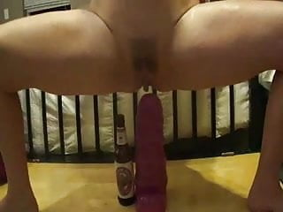 Girl squats on her dildo Squating on a massive purple dildo