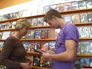 Pleasures erotic store - Tanned cock-crazed mom creamed all over in video store