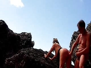 Tanned wife fingered and fucked - Lisa fingered and fucked among the rocks at the beach