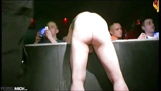 Public Spanking Club Session with German Dominatrix in Boots