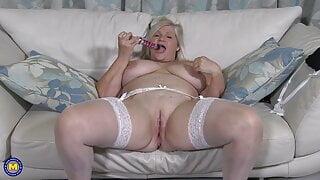 61YO busty granny Lacey Starr fucks her pussy