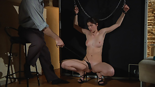 Cruel Master punishes his slave girl.