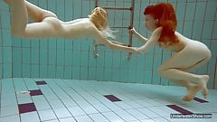 Two hot chicks enjoy swimming naked in the pool