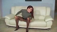 Redhead In Turtleneck Teases In Sheer Pantyhose