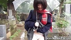 Cute Japanese chick has vibrator pleasing her in the rain