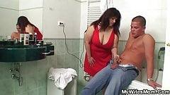 Busty mom and boyfriend in the bathroom