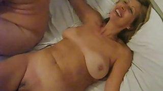 Smiling wife fucks husbands friend