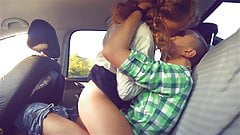 Cute teen girlfriend rides her boyfriend in car
