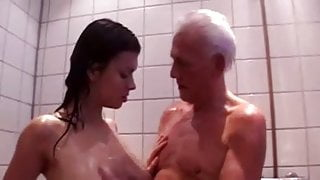 Old man and young girl showering together