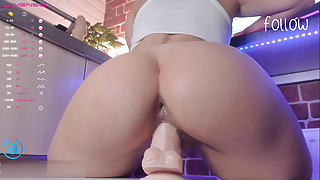 A beauty with a Beautiful Ass rides a dildo