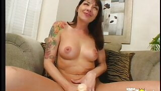 Horny brunette please her shaved pussy with a big dildo