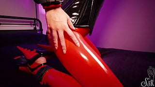 Renee chained in red latex, chastity belt, collar and cuffs