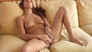Candice relaxing on the sofa with big pink dildo