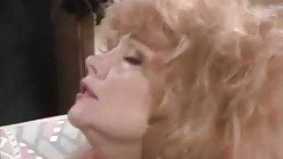 Leanne Lovelace makes love on a sofa