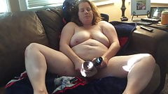 BBW mom with hairy pussy on the couch with black dildos