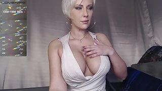 Slim blonde shows her body and masturbates on camera