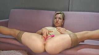 Russian blonde with a beautiful ass caresses her pussy