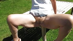Fucked on the garden table after she masturbated for cars