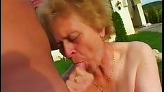 old grandma and young man having sex in the garden