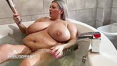 Huge tits British Milf reading a porn mag in the bath