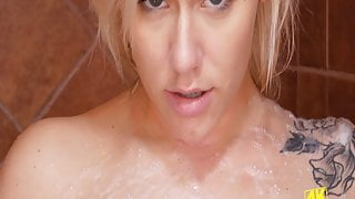 Alluring blonde spreads foam over body in 4K Shower