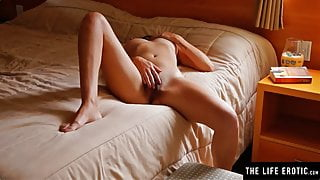 Natural beauty fingers her hairy pussy in a private moment