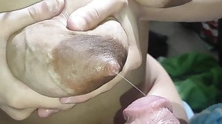She squirts the milk from her tits and I break her pussy
