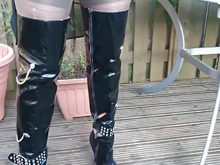 Pissing lesbians in thigh boots Thigh boots and layered in the garden