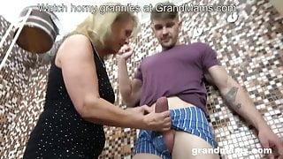 Horny step mom sucks stepson's fat cock in the bathroom