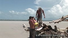 Horny latina gets a double penetration at the beach