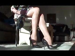 Legs in tan pantyhose Long legs in tan stockings and pumps